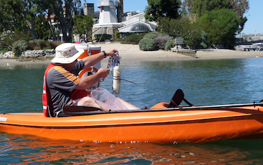 Brent Hepner sampling for environmental testing labs, so easy you can do it in a kayak